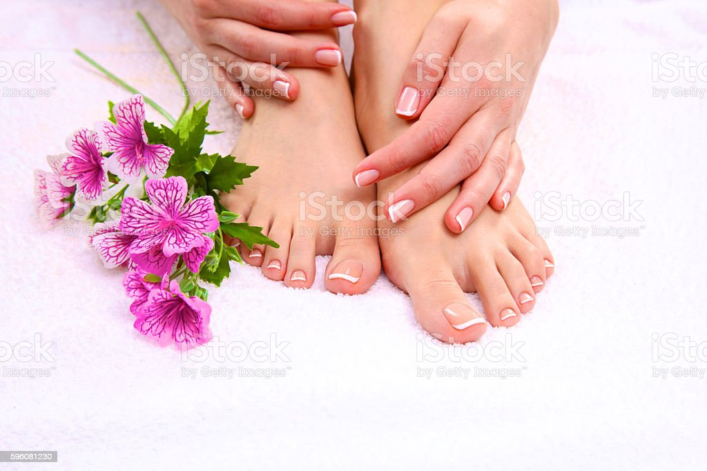 pedicure on legs and beautiful manicure  hands closeup royalty-free stock photo