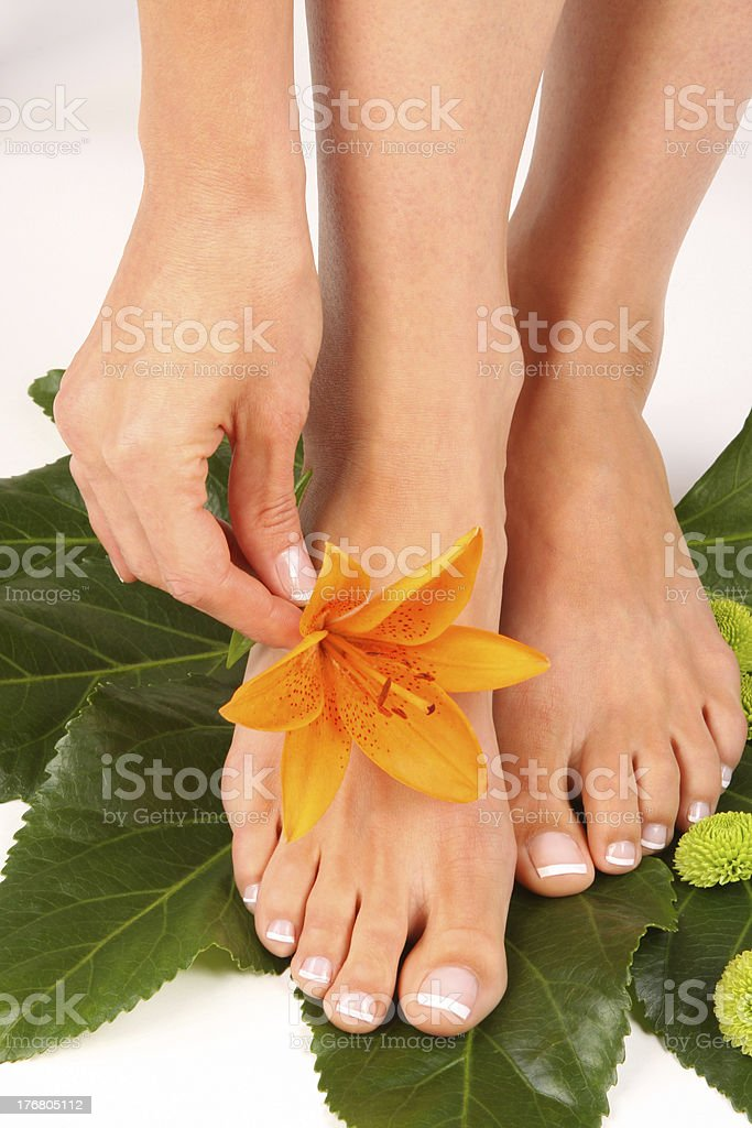 Pedicured feet with flower stock photo