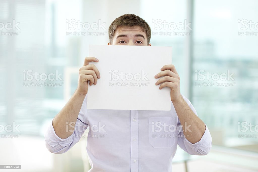 Peeking out of paper royalty-free stock photo