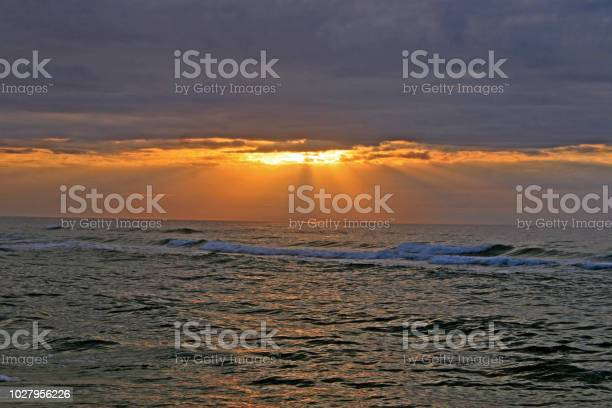 Photo of Peeking Sun and Clouds