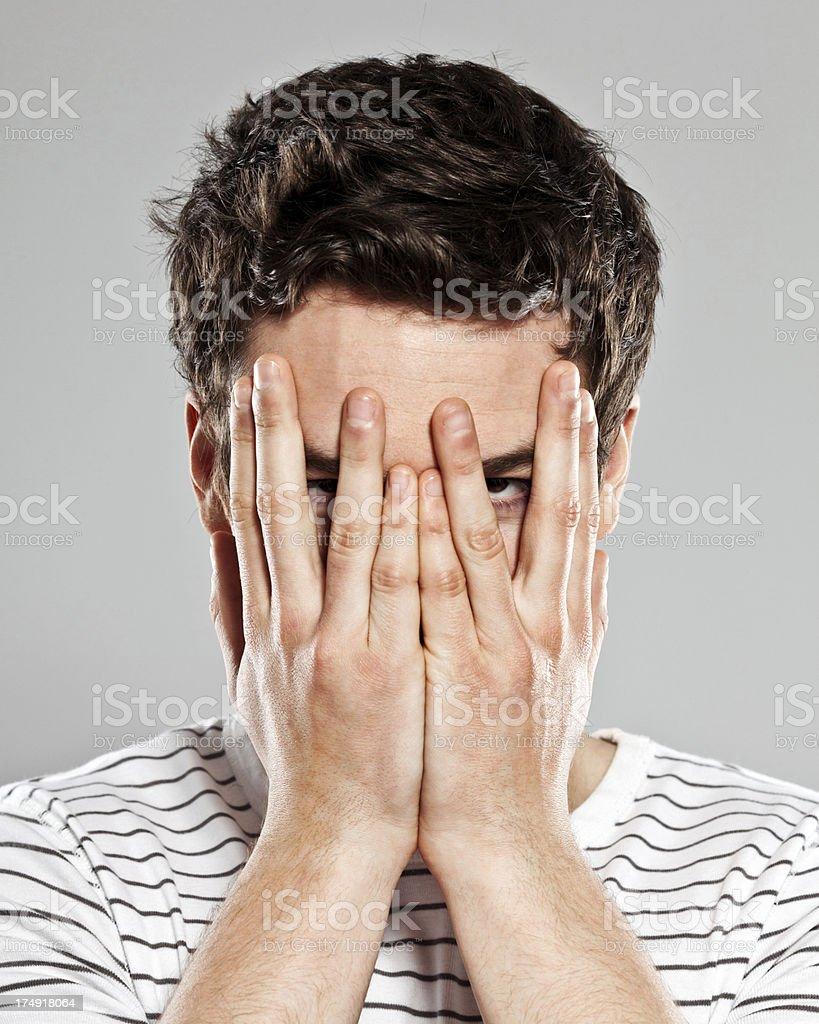 Peeking through fingers stock photo
