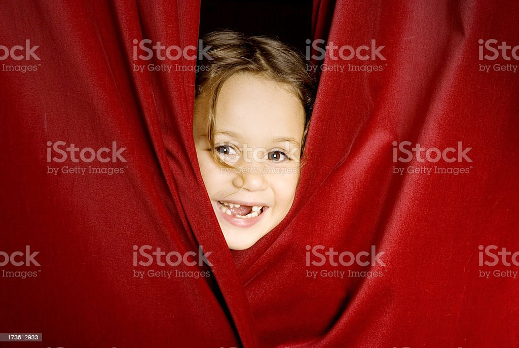 Peeking through the curtain rail stock photo