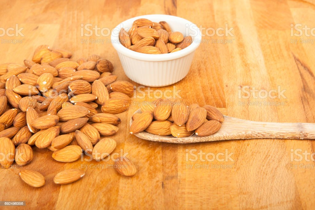 Peeled almonds closeup stock photo
