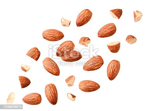 Peeled almonds whole and pieces flying on a white background. Isolated