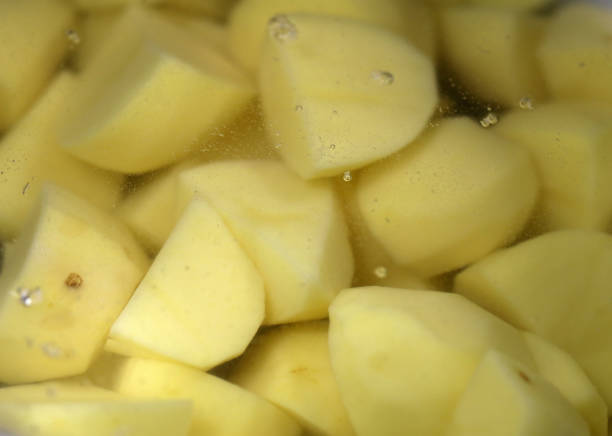 Peeled and Chopped Potato Pieces Underwater stock photo