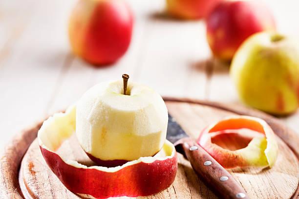 peeled apple stock photo