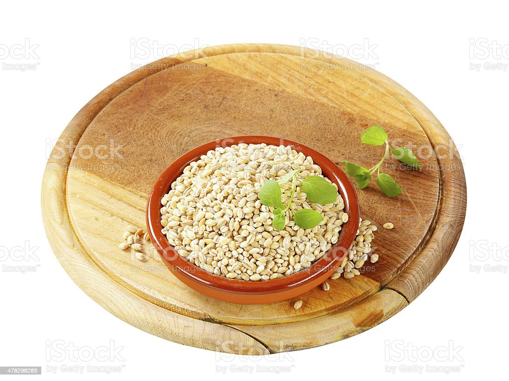 peeled barley in bowl on cutting board royalty-free stock photo