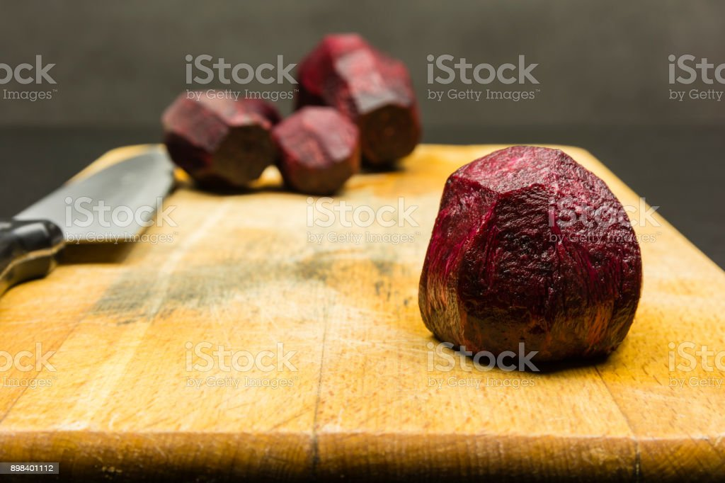 Peeled beetroot on a chopping board. stock photo