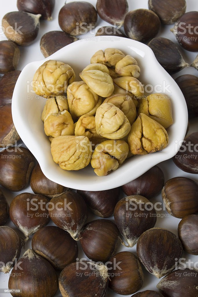 Peeled chestnut in a bowl royalty-free stock photo