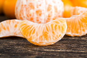 Close up color image depicting a bowl of freshly prepared - peeled and chopped - chunks of citrus fruit, including lemon and grapefruit. Room for copy space.