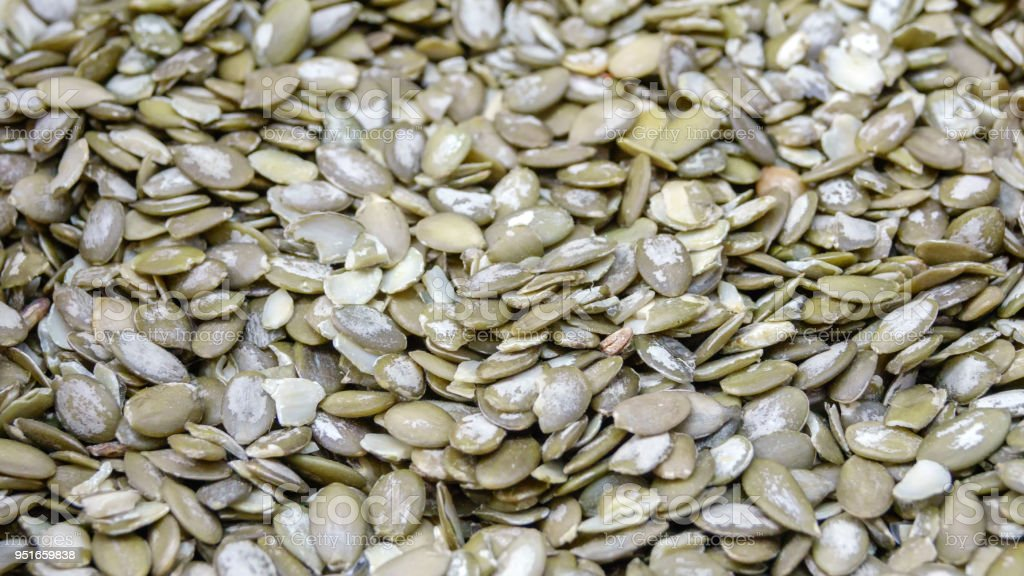 Peeled kernels of pumpkin seeds stock photo
