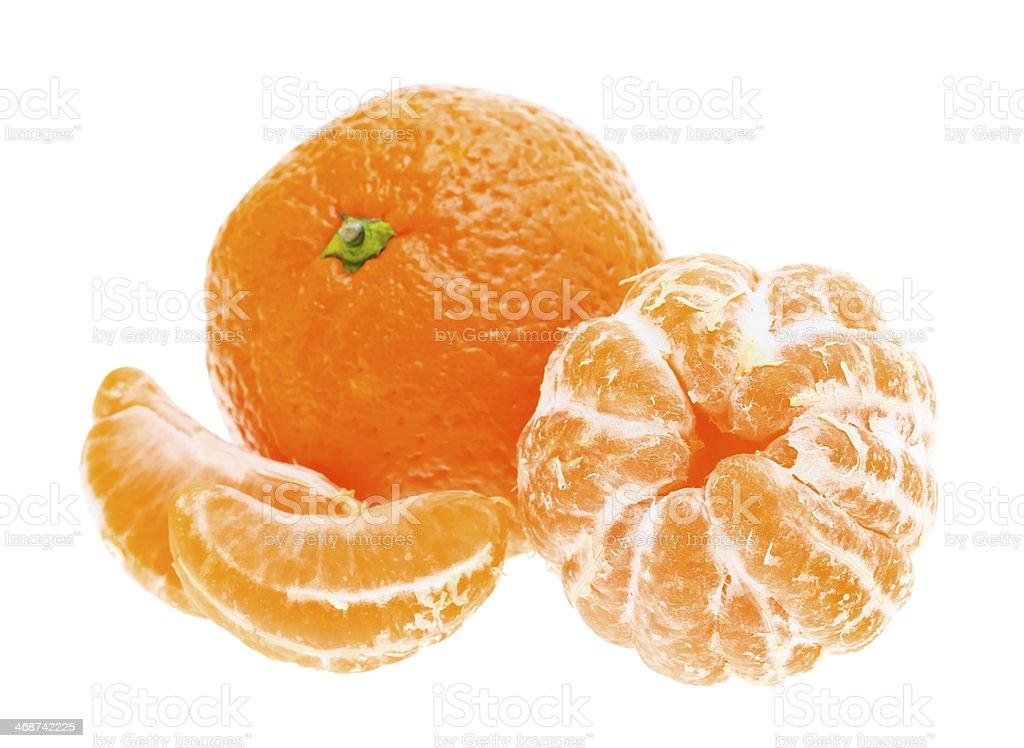 Peeled mandarin tangerine orange fruit isolated on white backgro royalty-free stock photo
