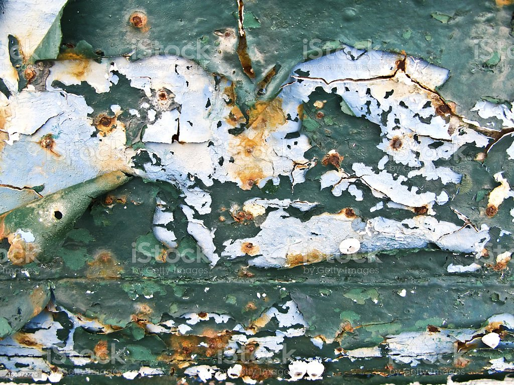 peeled paint over wood boards from a boat hull royalty-free stock photo