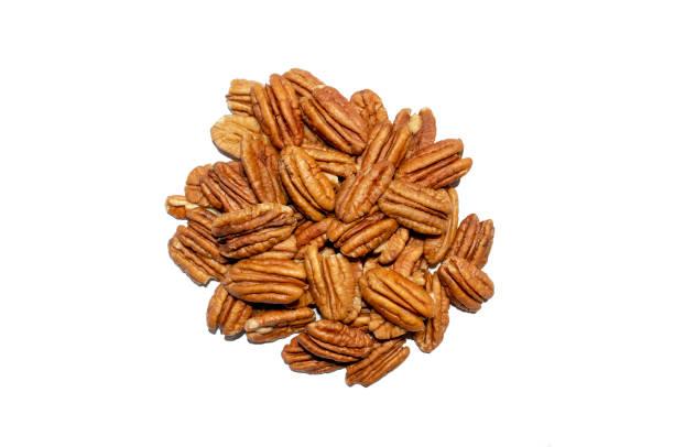 Peeled pecan nuts isolated on white background stock photo