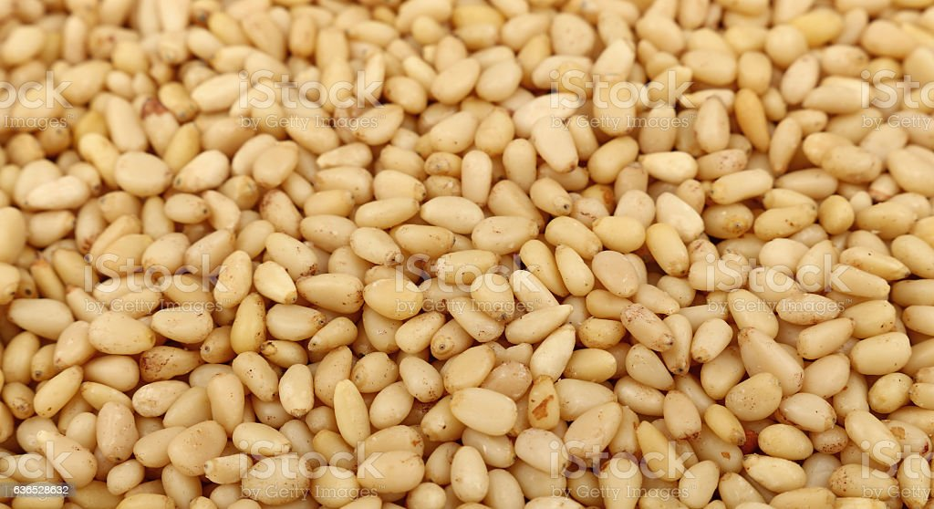 Peeled pine nuts close up high angle stock photo