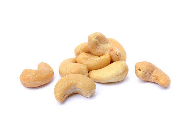 peeled salted cashews - cashew stock photos and pictures