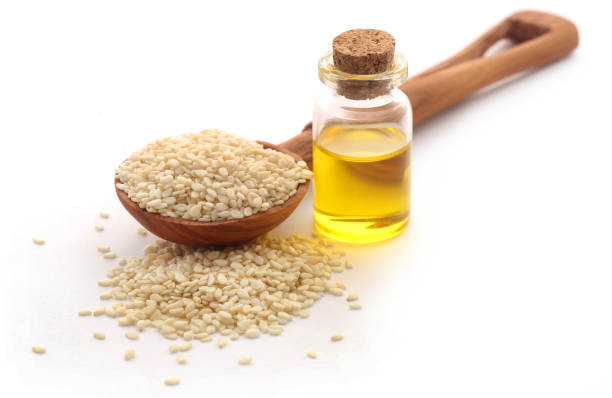 Peeled sesame seeds with oil stock photo
