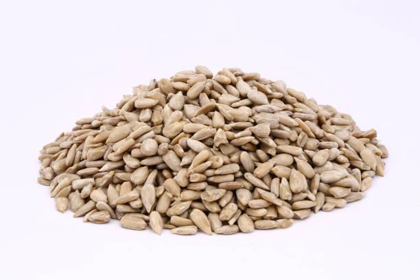 Peeled sunflower seeds on a white background stock photo