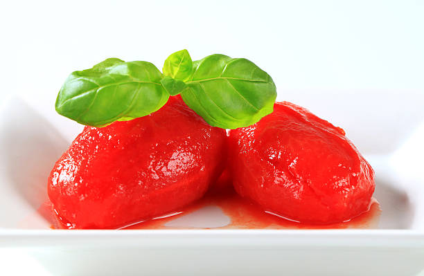 peeled tomatoes - tomato can stock photos and pictures
