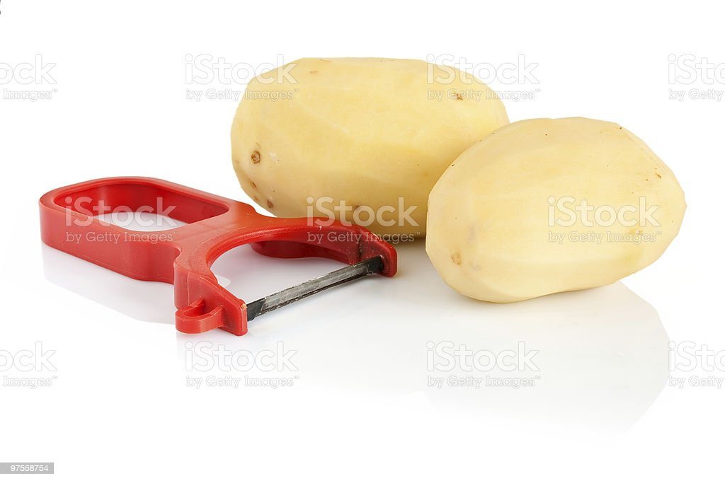peeler with two potatoes royalty-free stock photo