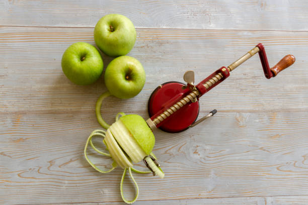 Peeling and coring Granny Smith apples stock photo