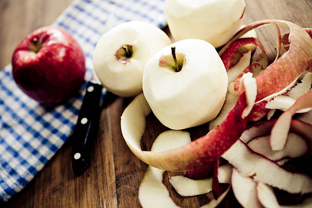 Peeling apples stock photo