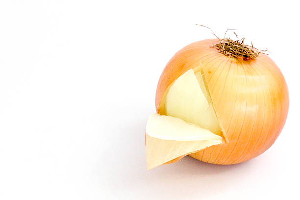 Peeling back the the onion isolated on white