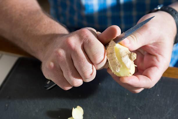 Peeling Ginger stock photo