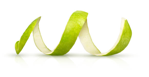 Peeling green apple on a white background stock photo