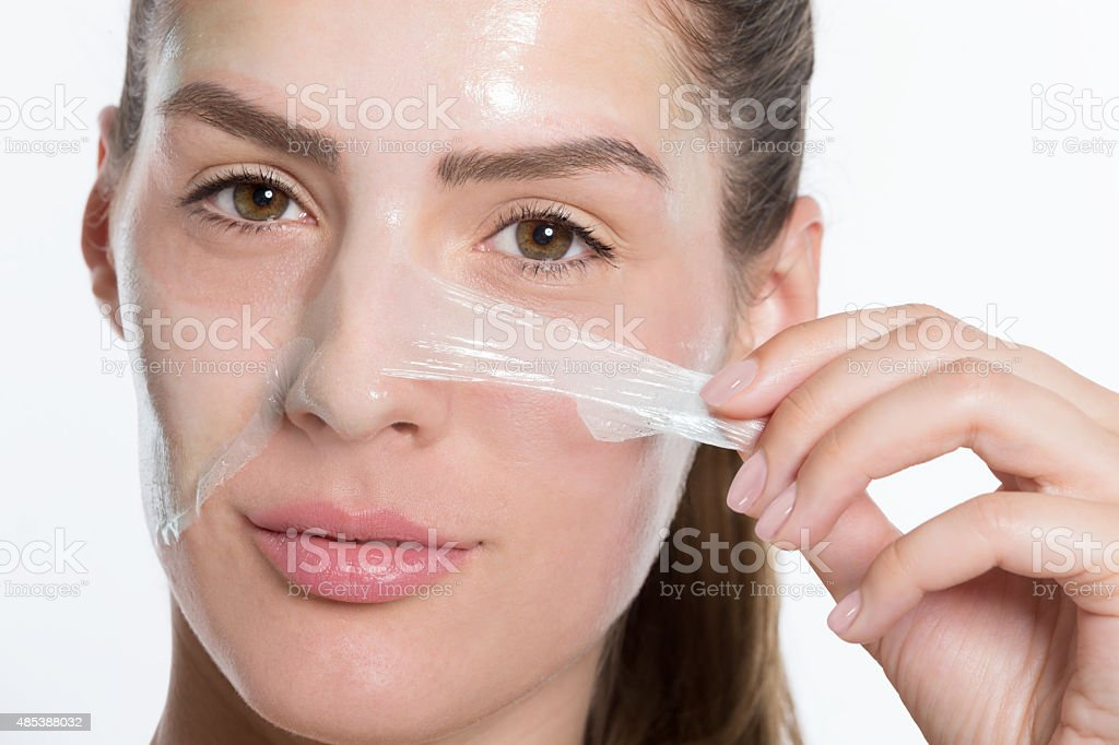 Peeling off facial mask stock photo