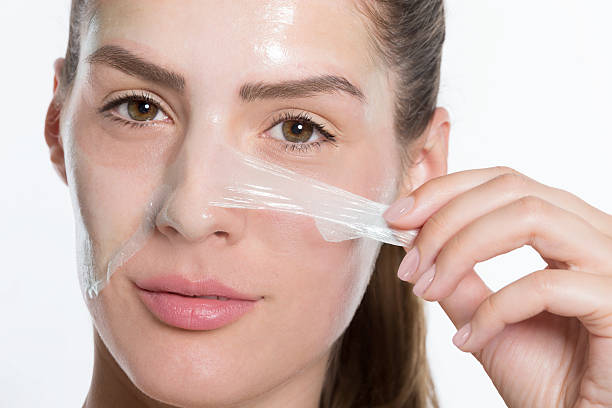 peeling off facial mask - peeling off stock photos and pictures