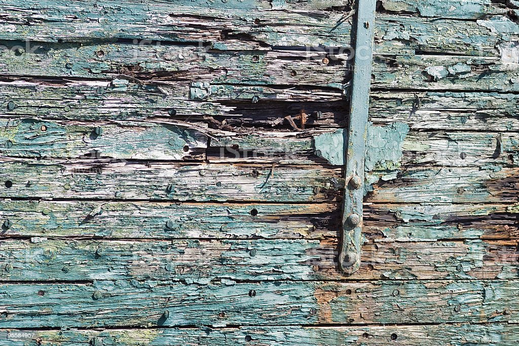 Peeling pain on side of old boat; texture and color royalty-free stock photo