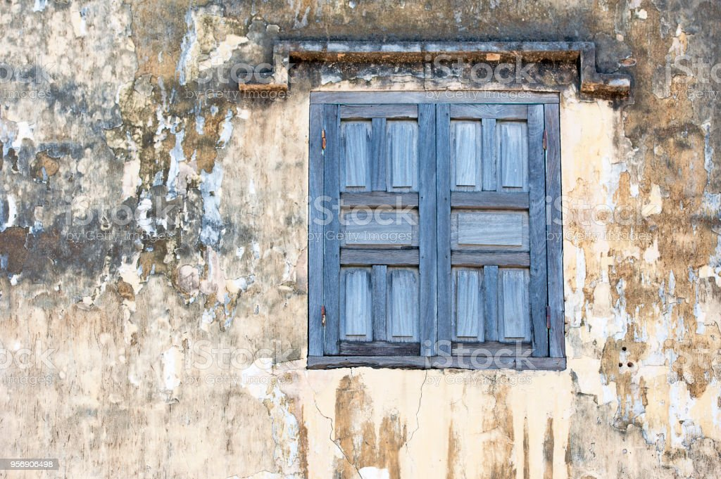 Peeling paint and decaying window shutter, Nha Trang, Vietnam stock photo