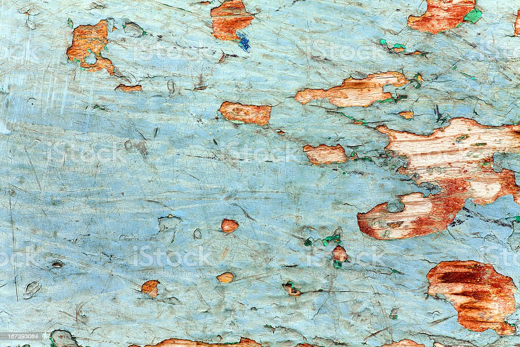 Peeling paint and weathered wooden wall texture royalty-free stock photo