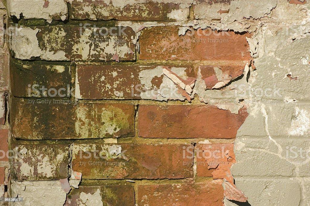 Peeling paint on a brickwall royalty-free stock photo