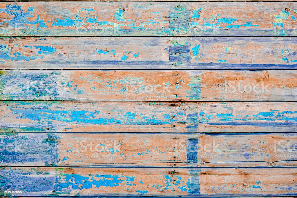 Peeling paint on an old wooden wall. Obsolete background. royalty-free stock photo