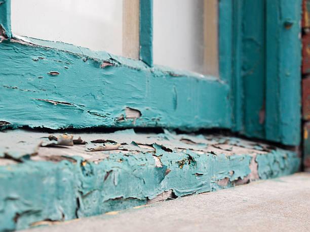 Peeling paint on old window sill stock photo