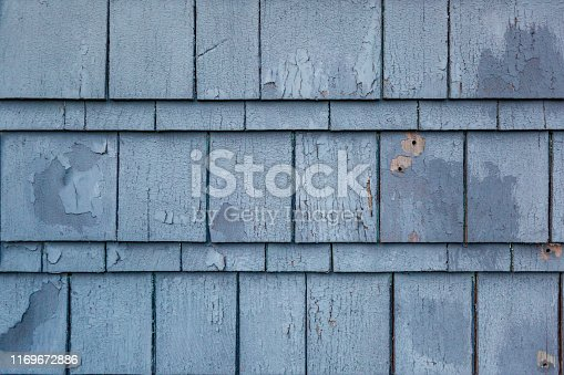 istock Peeling paint on wood siding 1169672886