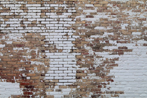 peeling paint vintage old brick garden wall stock photo