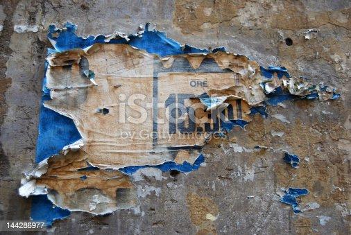 istock Peeling poster on wall 144286977
