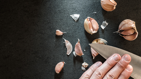 Peeling the garlic with a knife