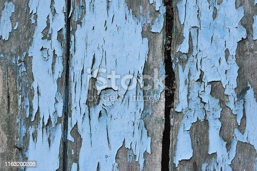 Peeling turquoise wood panels