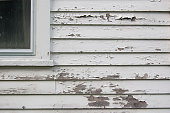 Peeling white paint on siding