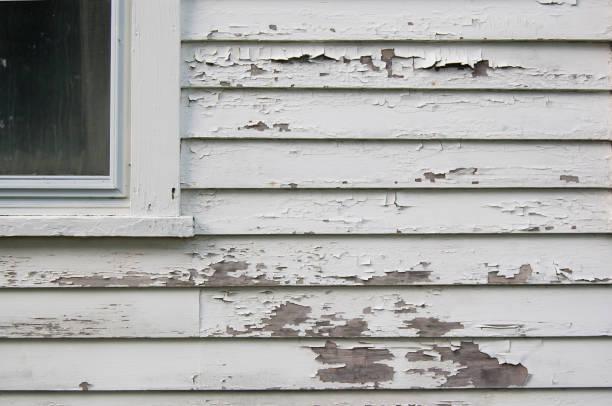 Peeling white paint on siding stock photo