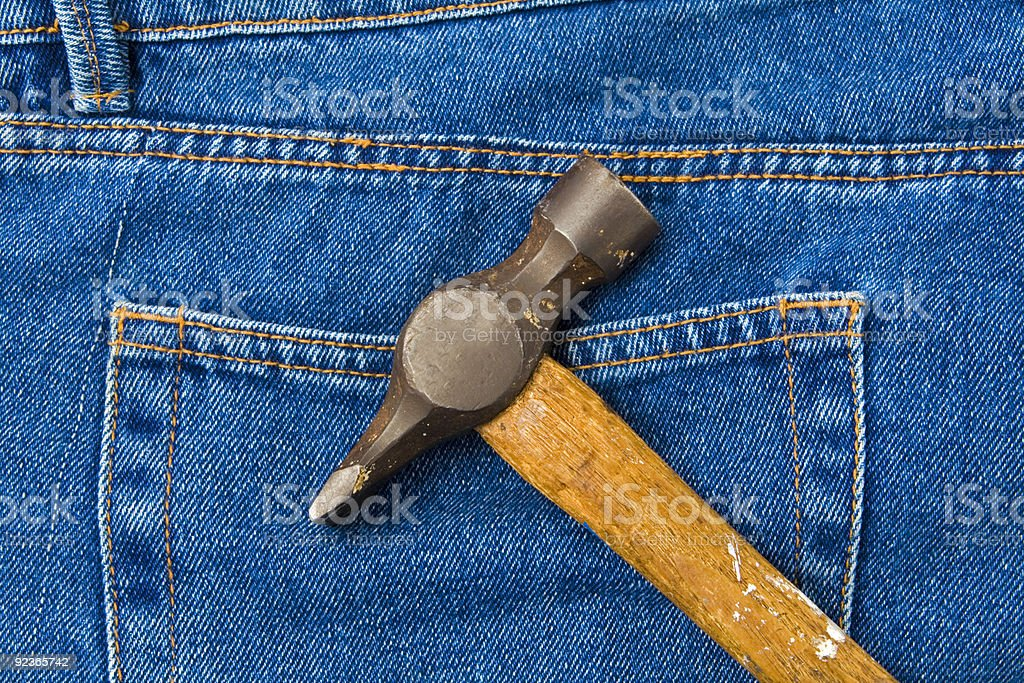 Peen hammer on jeans royalty-free stock photo