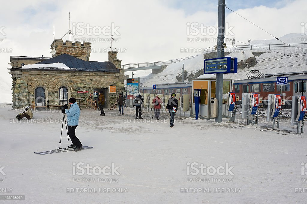 Peeople walk at the Gornergratbahn railway station in Zermatt, Switzerland. stock photo