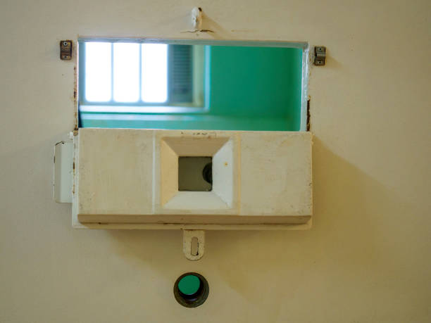 Peep Hole in the door to a Prison Cell stock photo