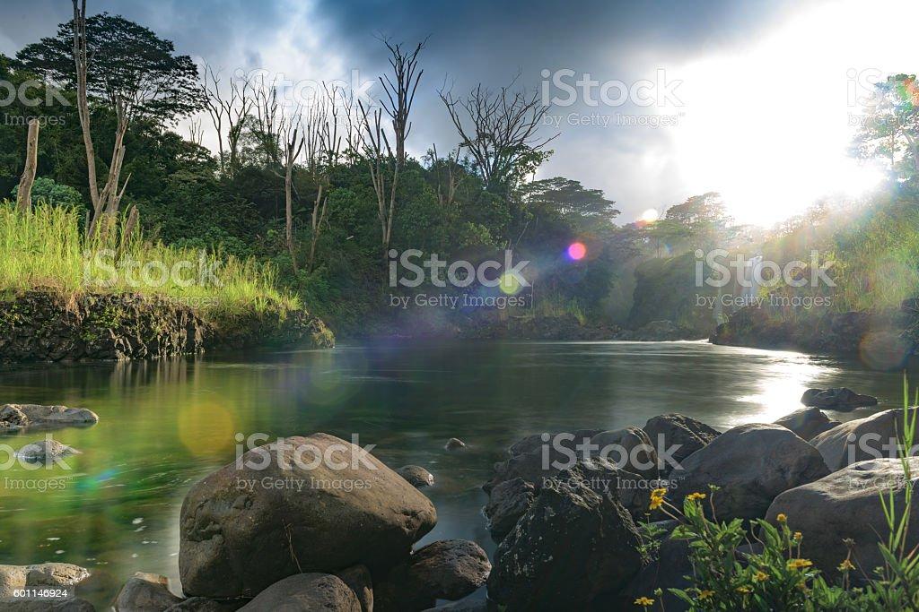 Pe'epe'e falls on the Wailuku river with dramatic light stock photo