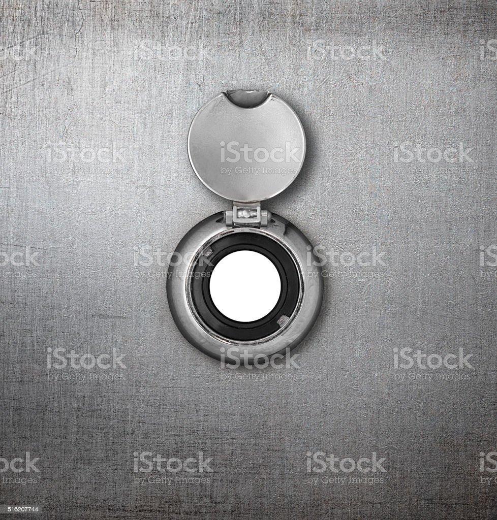 peephole or peep hole in metal door stock photo