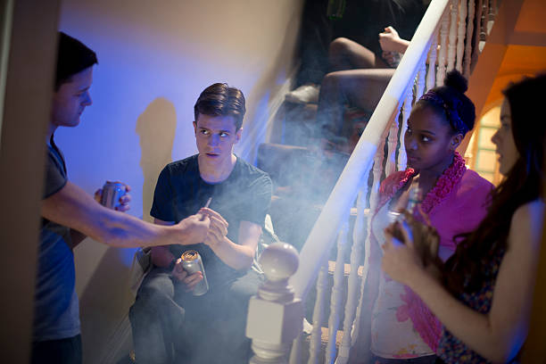 peer pressure at a house party - recreational drug stock pictures, royalty-free photos & images